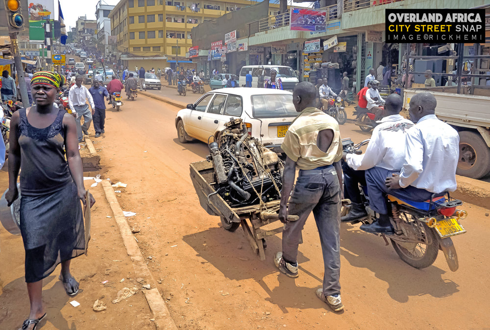 solo travel Africa, city street snap by Rick Hemi