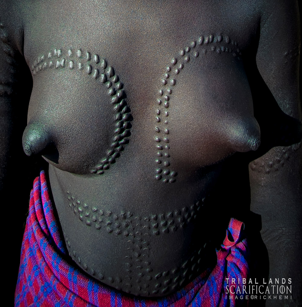 solo travel overland Africa, tribal scarification, image by Rick Hemi