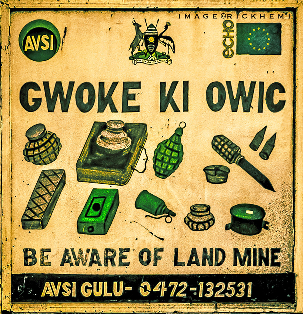 overland travel and transit Africa, land mine warning road sign image by Rick Hemi