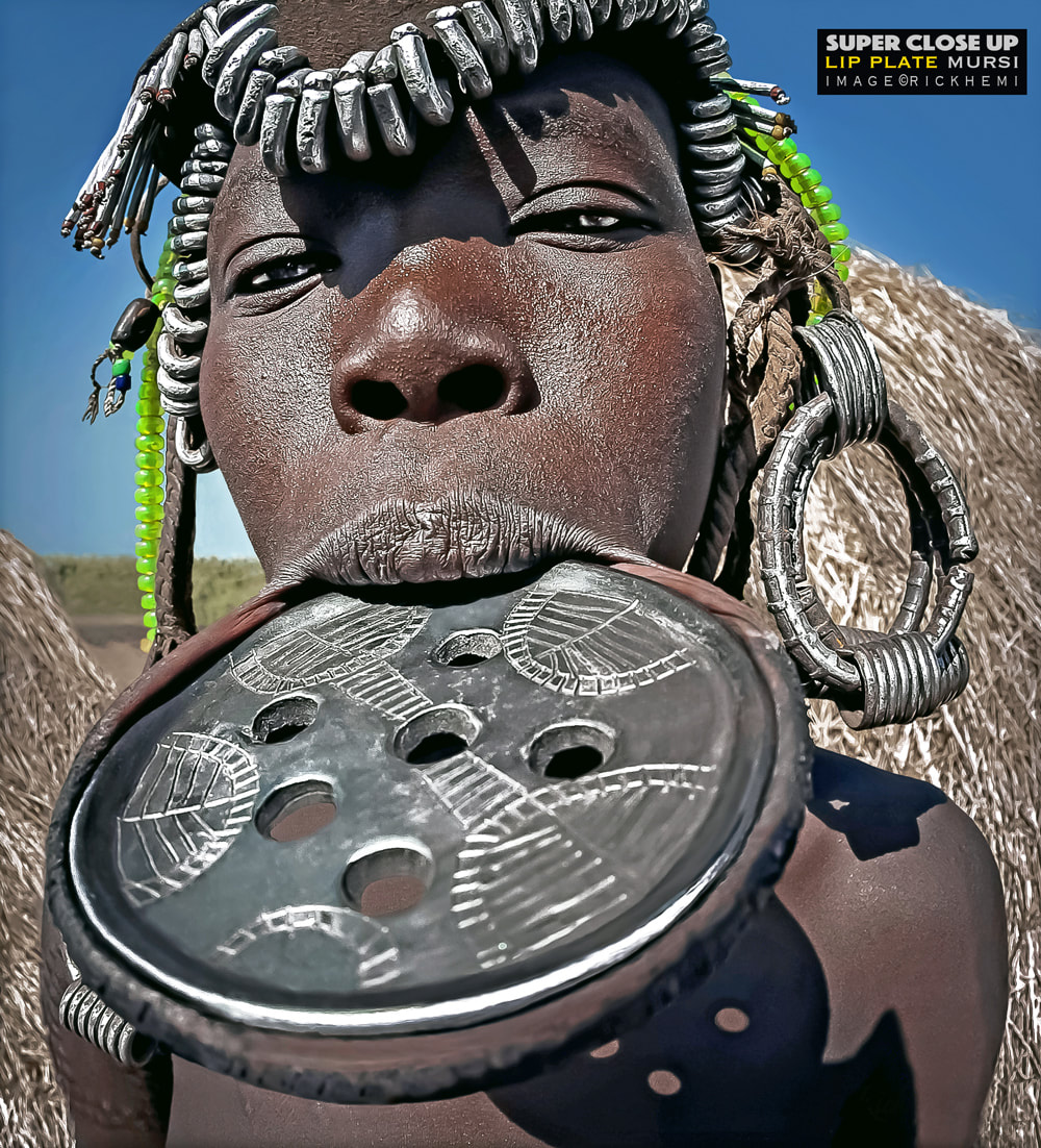 overland travel Africa, indigenous tribal portrait Africa, Lip plated Mursi image by Rick Hemi