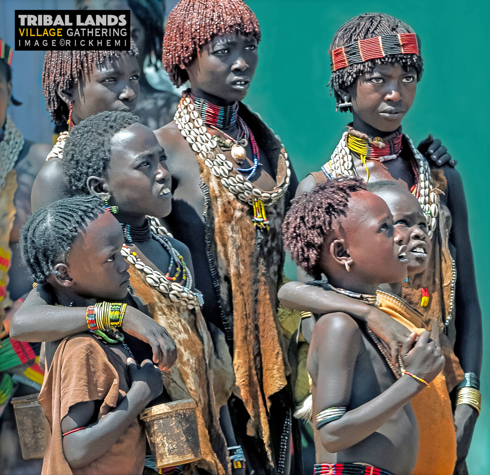solo travel tribal lands Africa, village gathering, image by rick hemi