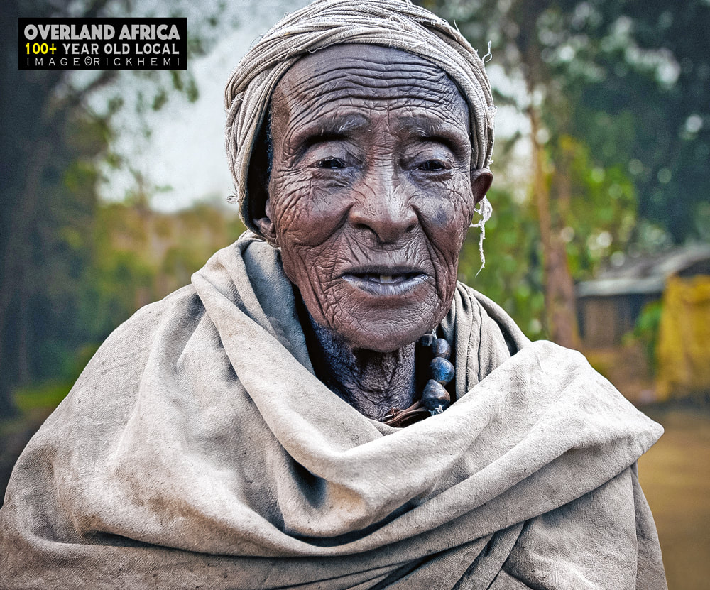 solo travel Africa, street photography,  100+ year old local,  image by Rick Hemi