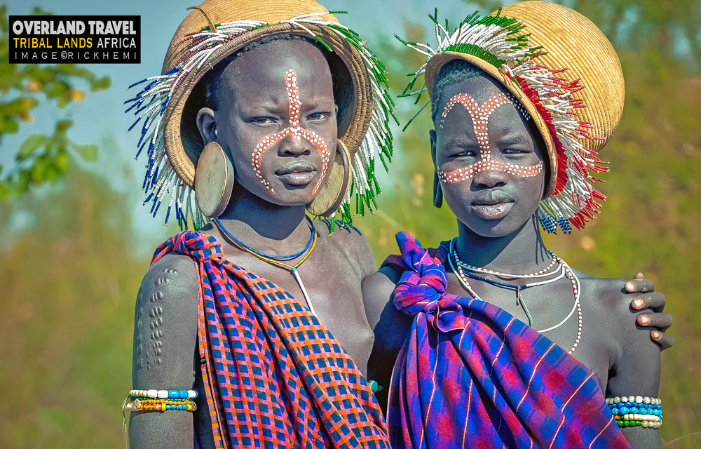 Tribal sisters portrait Africa, image by Rick Hemi